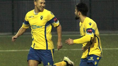 Adrian Markus (left) celebrates after his long-range opener. Picture: Tony Gay