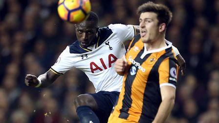 Moussa Sissoko (left) curls a shot around Hull City's Harry Miguire at White Hart Lane on Wednesday