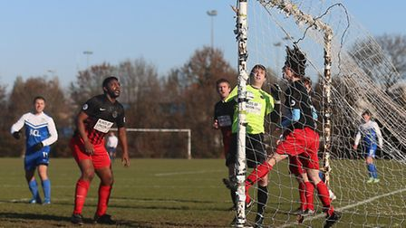 FC Krystal score their first goal during a 5-3 win against Mustard (red/black) in the Hackney & Leyt