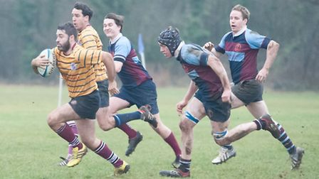 Tom Arnold (left) set up UCS Old Boys' first try and scored the second himself. Picture: Nick Cook