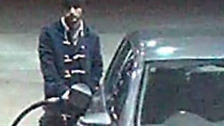 CCTV still of the suspect filling up a Volkswagen Golf at a nearby petrol station