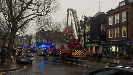The scene in Hampstead High Street yesterday morning Picture: Tim Goss