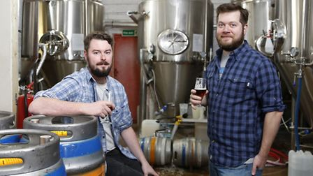 Hackney Brewery's two founders, Pete and Jon with their shiny new equipment – and some beer