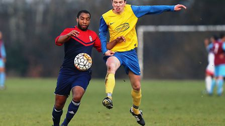 Shakespeare (red/blue) defeated FC Niva 3-0 in the Albert Daniels Cup. Pic: Gavin Ellis/TGS Photo