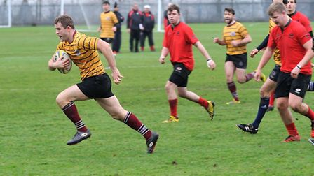 Inside centre Gwyn Edwards (left) breaks away to score the first of UCS's two tries on Saturday. Pic