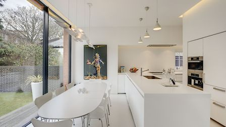 The kitchen has a clever broken plan layout for sociable privacy