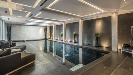 Even the indoor pool is decorated with fashionable tiles in glistening greys