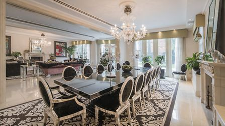 The dining room with it's imposing black lacquered table seats 14 guests