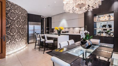 Don't feel like the dining room? Don't worry, there's even a chandelier in the eat in kitchen