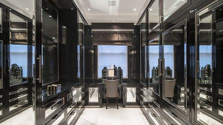 One of the dressign rooms is fitted out in hyper masculine black and chrome