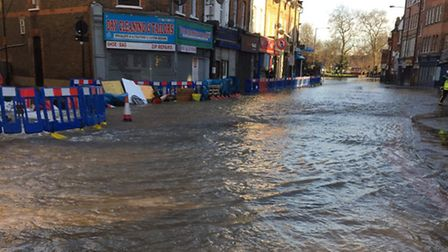 The road was flooded yesterday afternoon but the pipe had been leaking all week. Picture: Hackney Po