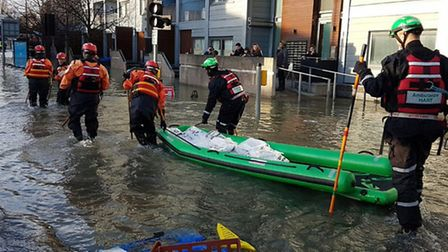 People were evacuated from their homes by the emergency services who brought their dinghys. Picture: