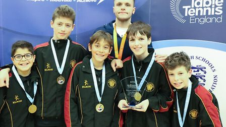 Members of UCSs Under-13 boys team show off their gold medals while meeting Aaron McKibbin, who ha
