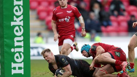 Chris Ashton beats the tackle of Scarlets' Tadhg Beirne to score Saracens' late equalising try on Su