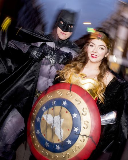 Batman and Wonder Woman take part in the Lowestoft Christmas Spectacular parade through the town cen