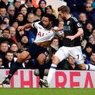 Mousa Dembele (left) keeps the ball away from West Brom's James Morrison at White Hart Lane on Satur