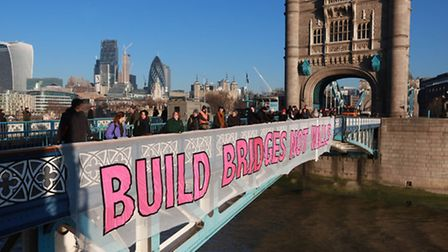 One of the banners made at Five Points' Mare Street warehouse is unfurled at Tower Bridge. Picture: