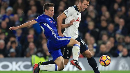 Harry Kane (right) tries to get away from Chelsea defender Cesar Azpilicueta during Tottenham's 2-1