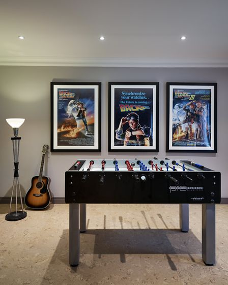 The games room includes posters of Back to the Future - the boys' favourite film