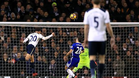Dele Alli scores the first of his two headers against Chelsea at White Hart Lane. Picture: PA