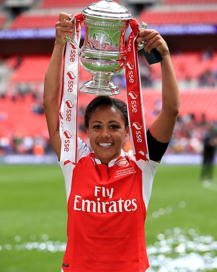 Arsenal's Alex Scott holds the trophy and celebrates after winning the SSE Women's FA Cup Final at W