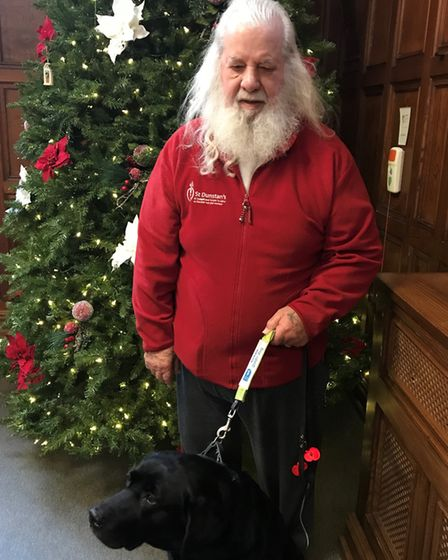 Mike with his guide dog Alice. Picture: Courtesy of Blind Veterans UK