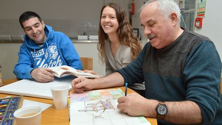 Tutor Ruby London runs an art class at St Mungo's hostel with residents Thomas Ward (left) and Ronal