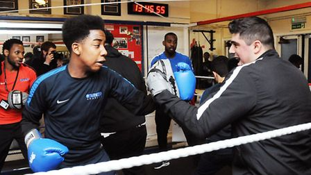 Coach Yilmmaz Mustafa (right) doing pad work with Jay Bramble, 14. Picture: Dieter Perry