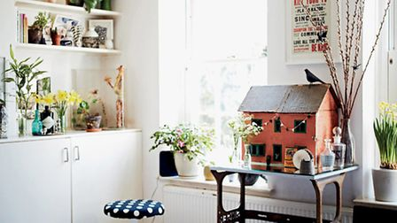 Personality filling this room with shelves flanking a chimney breast filled with treasures and plant