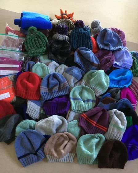 The YMCA Trinity Group donates hats for the homeless. The 82 hats. Picture: Courtesy of YMCA Trinity
