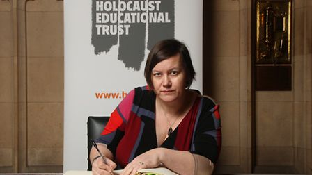 Meg Hillier MP signing the Holcaust Memorial Day Book of Commitment
