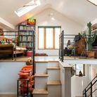 A space-saving staircase leads from the kitchen to a mezzanine-style sitting room