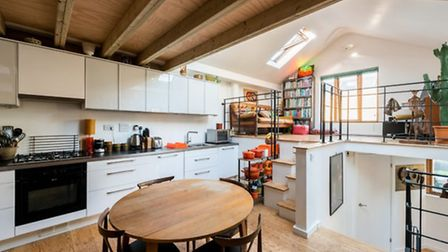 The living space forms the central area of the property with a modern fitted kitchen-dining room