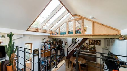 Across from the living room is another mezzanine, in the glazed, pitched roof, which is currently us