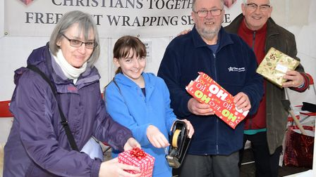 The Christians Together group wrapping presents in Lowestoft town centre last year. Picture: MICK HO