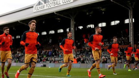 Tottenham Hotspur's Jan Vertonghen (centre) warms up before their FA Cup tie at Fulham (pic Nick Pot