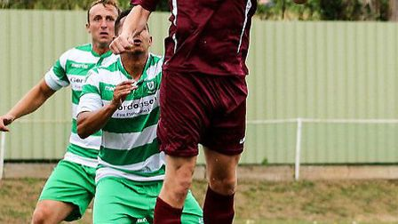 Wingate & Finchley's Sean Cronin came close to stopping Bognor Regis Town's first goal. Picture: DAV