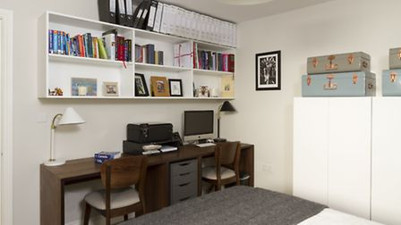 The bespoke double desk allows for a flexible home working space in the guest bedroom