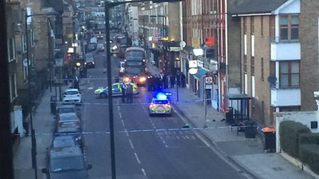 Police tape off the scene where a young man was stabbed in Green Lanes. Photo: @romaejaz on Twitter