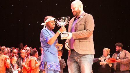 Hackney Mayor Philip Glanville presents the first prize trophy to 1st Impressions at the Boroughs Un
