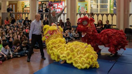 Highgate Primary School headteacher William Dean taming lions during the Chinese roadshow.