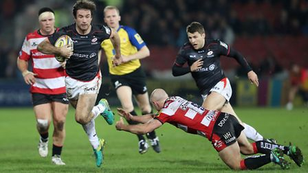 Saracens' Marcelo Bosch is tackled by Gloucester's Will Heinz during the Aviva Premiership match at