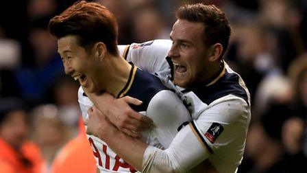 Heung-Min Son (left) celebrates his injury-time winner with Vincent Janssen, who set up the goal aft