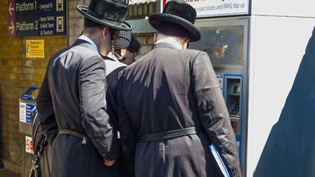 A file image of Orthodox Jewish men in Stamford Hill, where unregistered faith schools are causing t