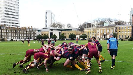 Hampstead (left) battle for the ball in the scrum in the picturesque setting of the Honourable Artil