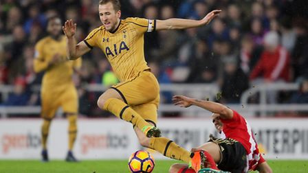 Harry Kane is challenged by Rodwell. Picture: PA