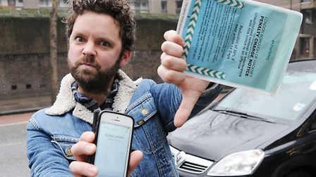 A furious Greg Bishop with his parking ticket. Picture: Dieter Perry