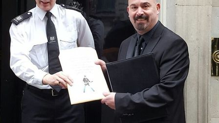 John Vasiliou handing in his petition in Downing Street on Sunday