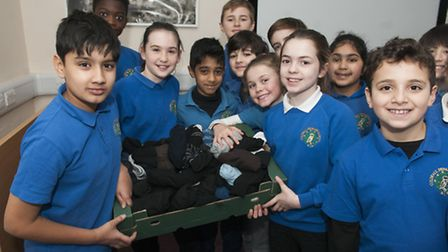 Children at Coldfall Primary School in Muswell hill with their SNUG packs bound for refugee camps in
