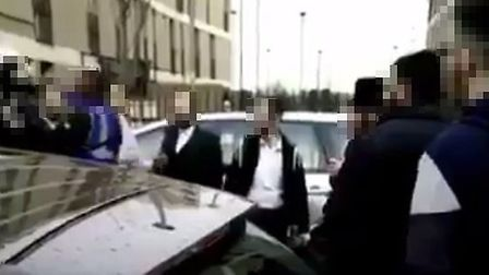 A still from video footage showing a brawl between a traffic warden and a group of men in Upper Clap